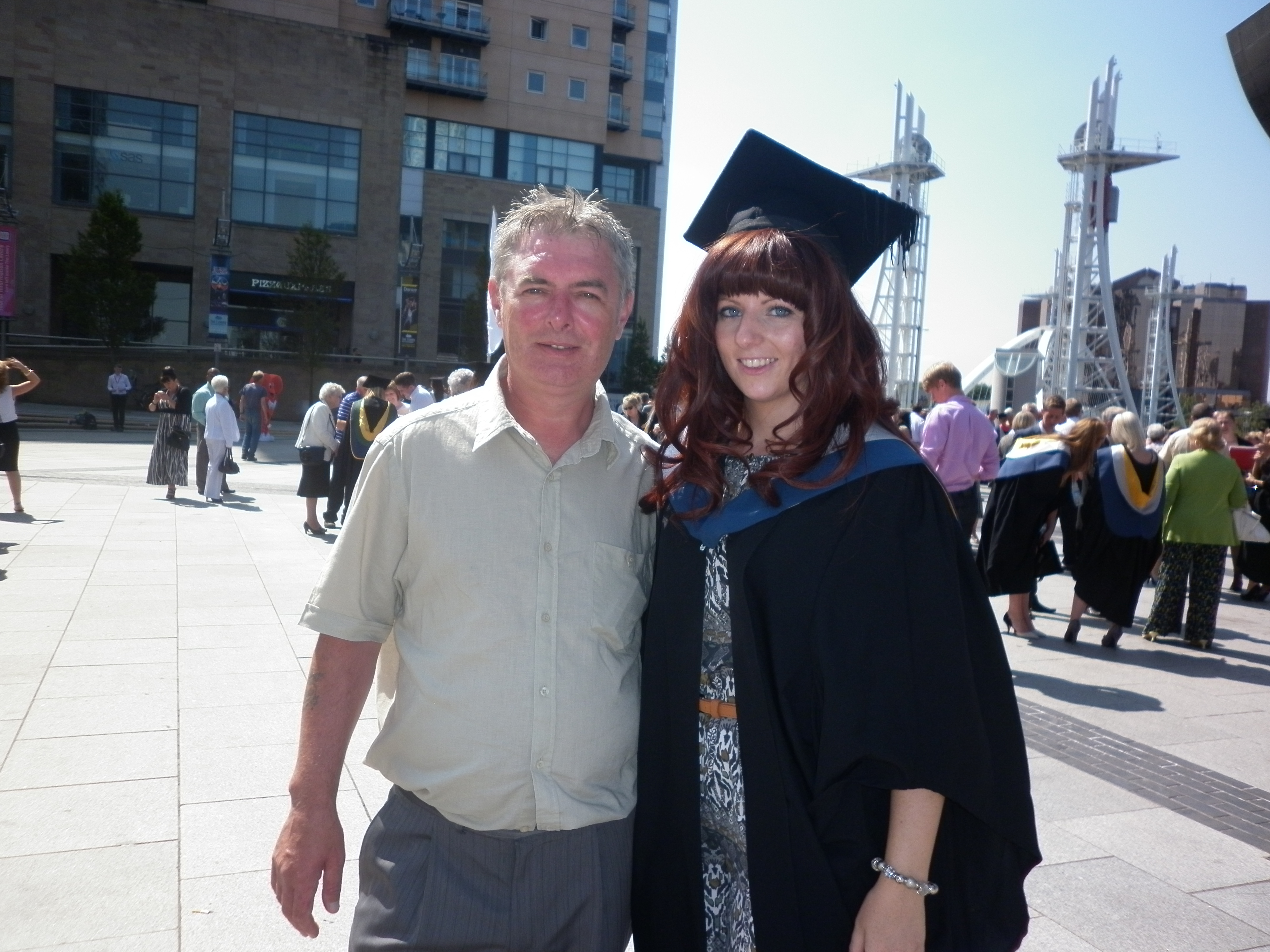 Ashley with her dad at Graduation Day 2013