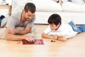 father-son-playing-checkers
