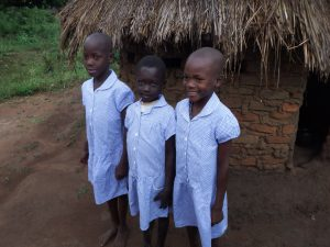 Children wearing gifts of school dresses brought by one of the volunteers © Penny Cook