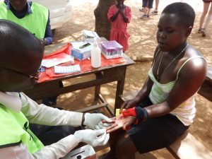 Taking a small drop of blood for HIV testing
